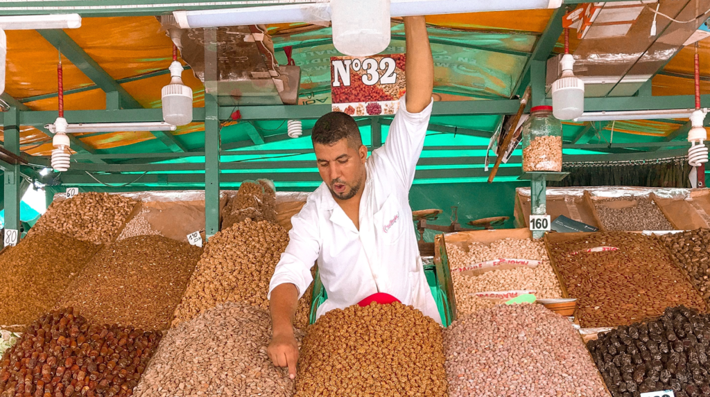 Merchant in market stand with spices